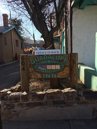 The Guadalupe Inn: Exterior signage and interior of room #11.