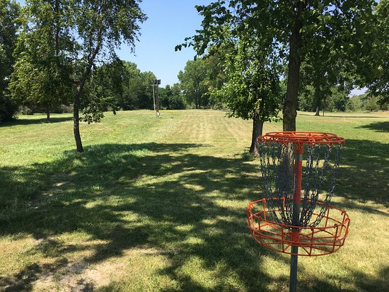 Hanna City, IL: The Wildlife Prairie Park Disc Golf Course is a championship level 18 hole course with elevation on nearly every hole. Surrounded by the beautiful scenery of several lakes, 3 of the holes even pass over bodies of water! Hole length ranges from as short as 200 feet on white tees and nearly 1,000 feet on gold tees. Landscape and terrain are hilly and wooded.  The disc golf course is located on the west side of Taylor Rd. across the street from the WPP Main Gate.
