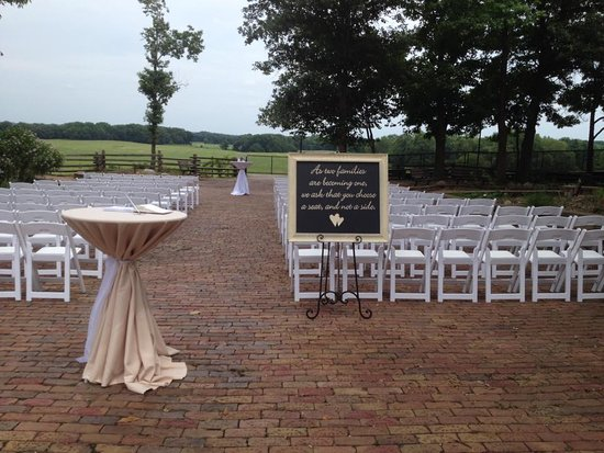 Hanna City, IL: Outdoor wedding ceremony overlooking the bison and elk pasture