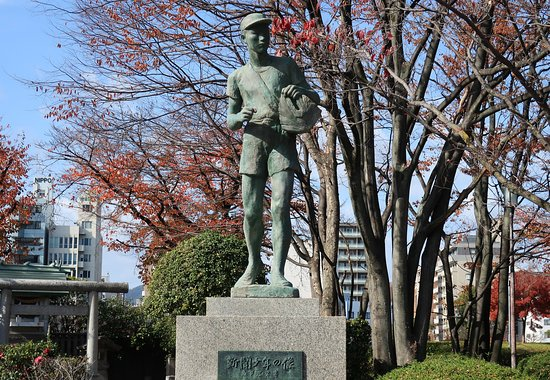 Statue of A Newspaper Boy