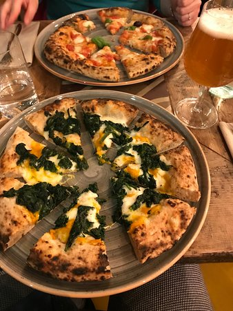 Spinach pizza and buffalo margherita & beer