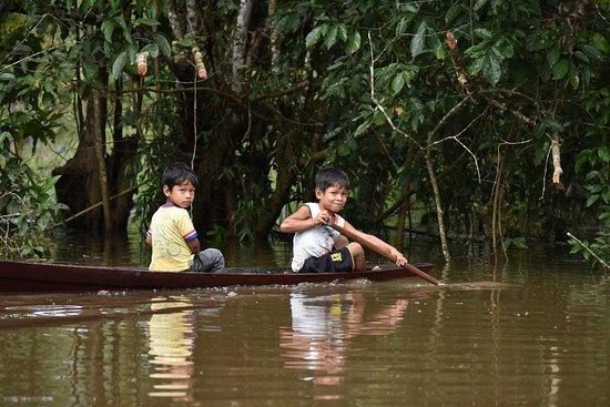 Iquitos Amazon Region, Peru: Local boys on a Sunday paddle