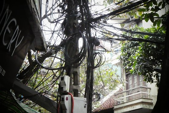 Hanoi Old Quarter: Hanoi's electrical and telecommunications spaghetti - buy the t-shirt in Hoi An - offer a third, settle on a half the initial price.