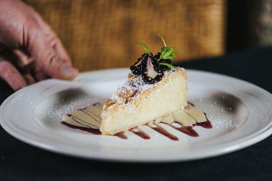 Emigrant, MT: Basque cake served with blackberry sauce, vanilla crème, and fresh blackberries.