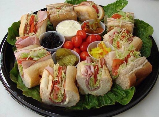 Monster Subs: catering tray of subs and fresh toppings