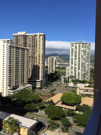 Queen Kapiolani Hotel: View looking behind hotel from balcony