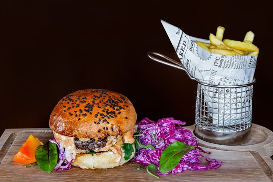 Delicious home-made wagyu burger with chips and vegetables