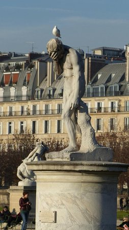 Statue Cain Venant de Tuer son Frère: Cain After Killing His Brother Abel (Cain Venant de Tuer son Frere), the works of French sculptor, Henri Vidal (1896) at Jardin des Tuileries