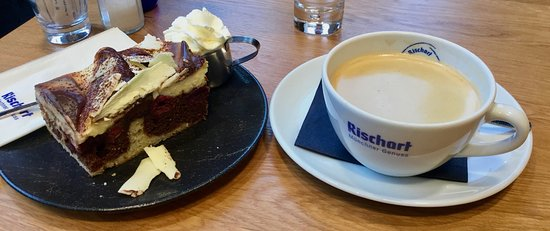 """At ** Cafe Rischart """"Die """" Donauwelle """" Chocolate layer with Cherries, topped with white chocolate mousse and white chocolate chips as well as fresh whipped creame. ... gone to HEAVAN — in Munich, Germany."""