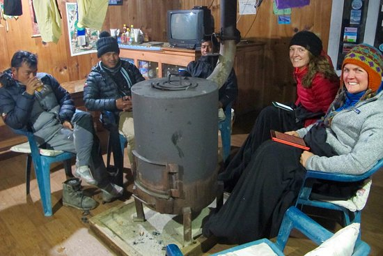 Himalayan Friendly Treks: Keeping warm by the stove with Ram and our incredible porters.