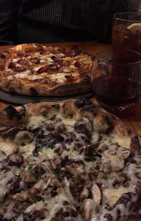 Kensington, MD: A pepperoni & anchovy with red sauce, and a mushroom, sausage & carmelized onion wood-fired pizzas! Yummmm!