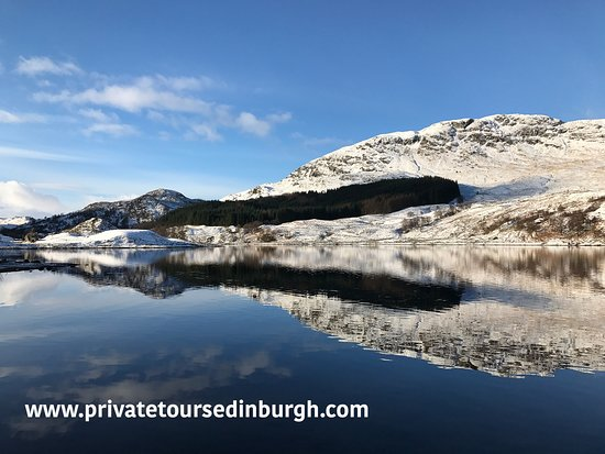 Crianlarich, UK: snow covered Loch Lubhair in winter in the Highlands of Scotland