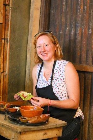 Jenny is eady to try a Guatemalan tostada.