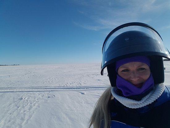 Springlike ice field attracts for a snowmobile safari in Sea Lapland
