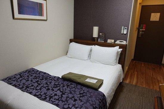 ห้องนอน มีชุดคลุมอาบน้ำวางให้ด้วย