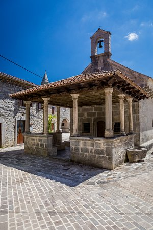 Gracisce, Croatia: A Late-Gothic church of the Mother of God na Placu, dominating the Square, was built to the right side of the Town Gate by Master Dento in 1425 to the order of the local villager-nobleman Petar Beračić.