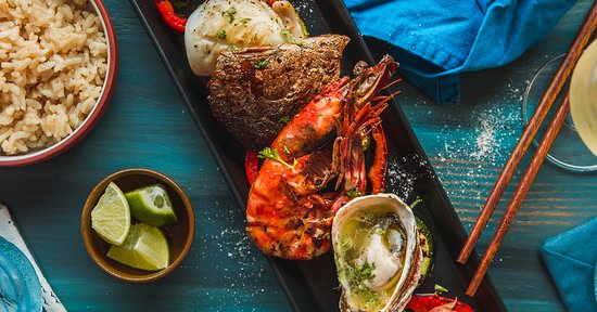Catch of the Day - Grilled mix of seafood, fish and veggies with rice Fresh Catch Vietnam - Seafood Mediterranean Restaurant