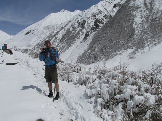 Gorkha, Nepal: Manaslu and Tsum valley trek, on our way to Samdo. suddenly there was heavy snowfall and team put on our boots on fresh snow while walking and made our way!
