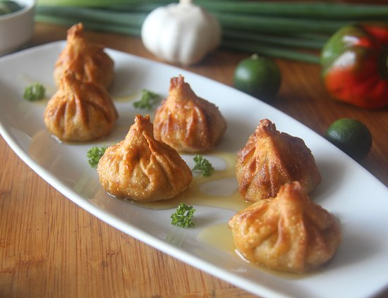 7 Fishes By Coco Veranda: Chorizo Puffs: Fried wontons filled with our homemade Chorizo Rekado and CHEESE!