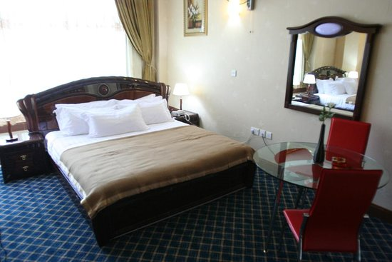 A single self contained room with a big bed