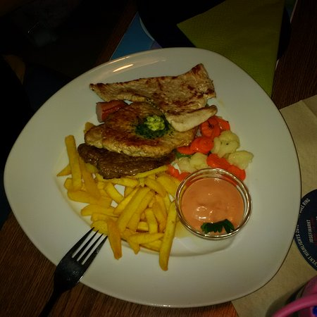 Zeltweg, Austria: mixed grill with vegetables and fries