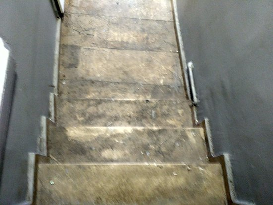 Filthy staircase to alternative rooms