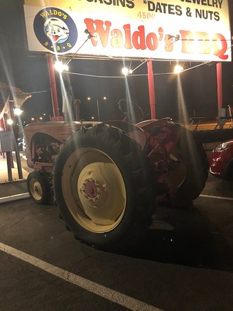Tractor in parking lot adds to the character of this restaurant.