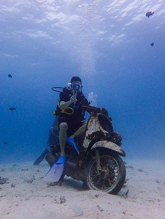customer sitting on a motorbike underwater