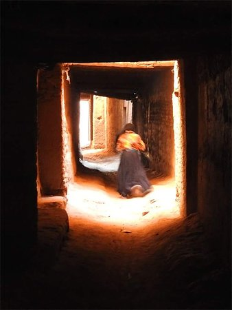 The covered street . Proper visit of an old construction called : Ksar . Cultural tours .