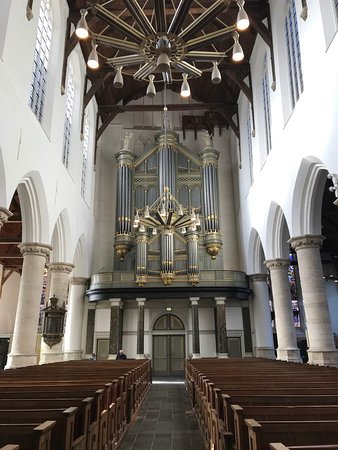 View towards the main organ dating back to 1857 in the central nave, with the new chandeliers