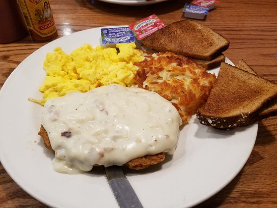 Mountain Home Cafe Inc.: Country fried steak, topped with gravy, served with two eggs, hash browns, and whole wheat toast