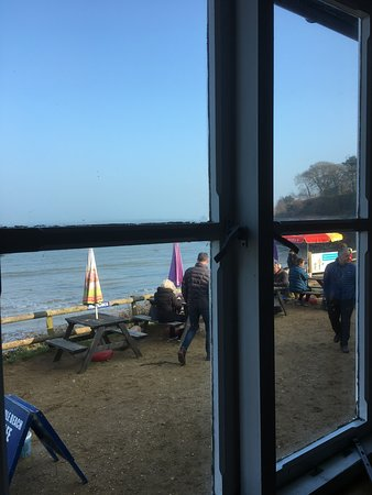 Middle Beach Cafe: View through window of cafe to outside bench seating