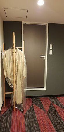 Cheap clothes rack in the room. Not very stable and of cheap quality.