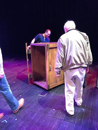 Looking at the box on stage.