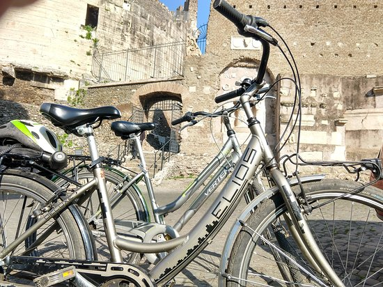 EcoBike: Biking on Appia Antica, stopped for a rest by medieval fortress built into pre-existing 2nd century burial tombs.