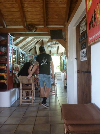 O Vivier: the waiter ... Note the T shirt is an ad for a local beer .