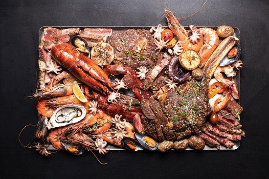 TRUE Steaks & Seafood RESTAURANT: Surf & Turf to unikalny sposób łączenia mięs i owoców morza, który pozwala tworzyć różnorodne i wyjątkowe kompozycje smakowe. Menu restauracji oparte jest na najwyższej jakości produktach. Świeże ryby i owoce morza z całego świata oraz wyselekcjonowane mięsa są fundamentem naszego menu --- Surf & Turf is a unique way of combining meat and seafood, which allows you to create a variety of unique flavors. The restaurant's menu is based on the highest quality products.