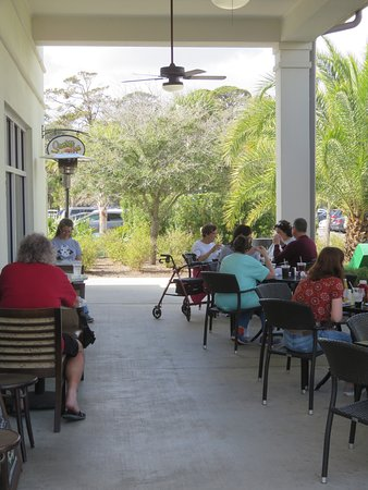 Outdoor seating on the covered sidewalk