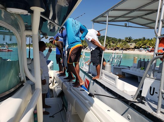 The locals surrounding the boat at the conclusion of the charter to see our two Wahoo. This is not common this time of year but, Roatan Island Charters went above and beyond.