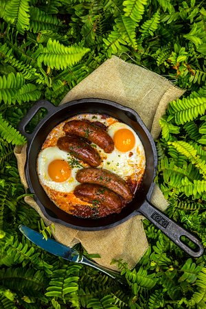 BAKED CHORIZO AND FARM EGGS - baked Sloane's chorizo sausage in a tomato casserole braised with onions served with farm vegetables.