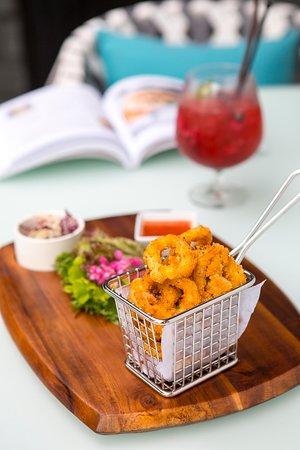 CAJUN-SPICED CALAMARI - calamari with a bite served with salad and sweet chili sauce.