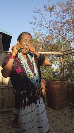 Traditional Tight Chin playing the flute, Kanpetlet, Chin State.