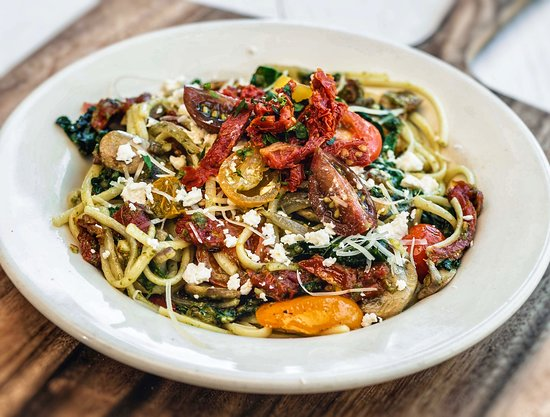 Vegetable Pesto Pasta... linguine with pesto, kale, mushrooms, red onion, sun-dried tomatoes, cherry tomatoes, feta