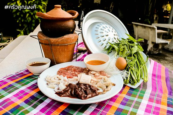 Thai style hot pot - a hot pot with PK's soup, fresh vegetables, egg, noodles, pork, liver , seafood, beef and sauce.