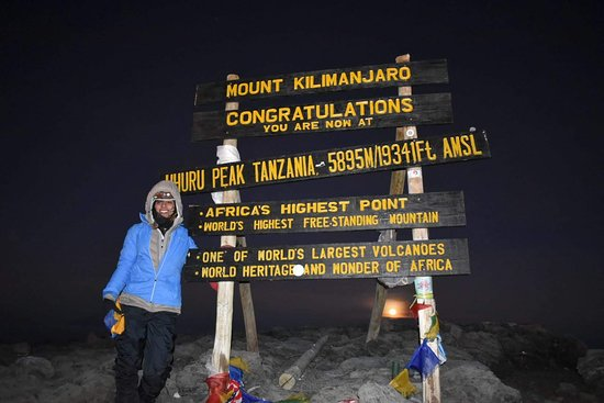 We got to Uhuru Peak right before sunrise (see the full moon in the background).