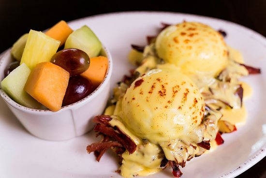 The Cherry Creeker our slow cooked award-winning corned beef hash topped with 2 poached eggs and hollandaise sauce (this dish made Syrup famous)