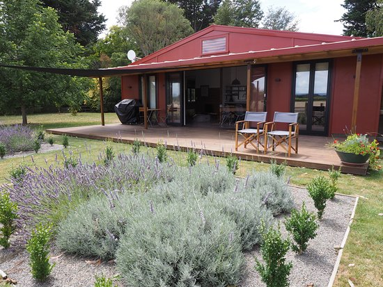River Road Retreat offers a beautiful setting in a private garden and truffiere, on 30 acres in Appleby, Nelson, New Zealand. Large open planning living areas open onto an extensive deck with views over the vineyards to the mountains.