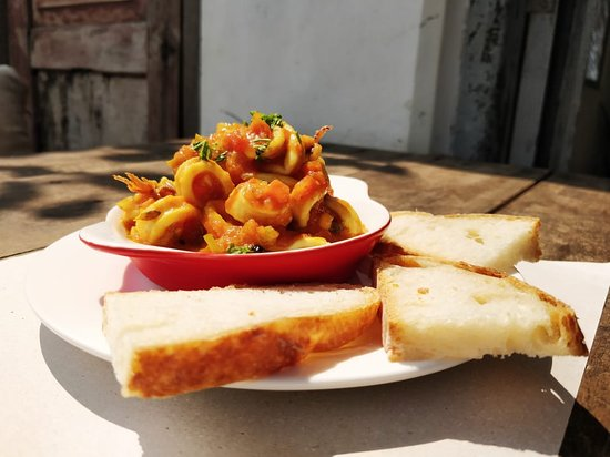 Calamari esccabéche is a fine mix of homemade tomato sauce and red wine vinagarfrom mediteranean area, Simple and delicious, perfect as a starter or snack.