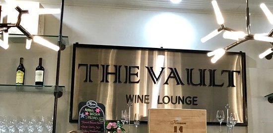 The Vault Wine Lounge: Signage behind bar