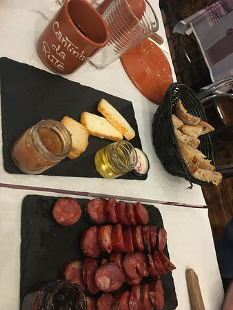 Treasures of Lisboa Food Tours: Forgot to take a picture before scarfing down the cheese but you can see the toasts, chorizo, local honey and quince jam!